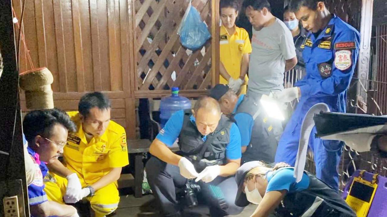 Thai forensics examine the crime scene